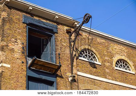 detail of old brick building in England with loading doors.