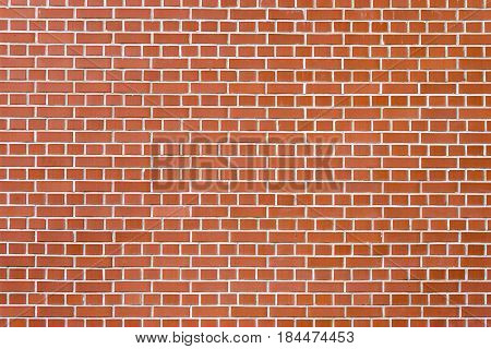 Background or texture made of red clinker wall