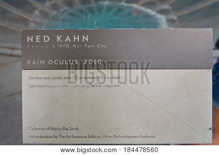 SINGAPORE - CIRCA NOVEMBER, 2015: close up shot of the Rain Oculus plate. Rain Oculus is a large whirlpool forms inside a 70 foot diameter acrylic bowl and falls 2 stories to a pool below.