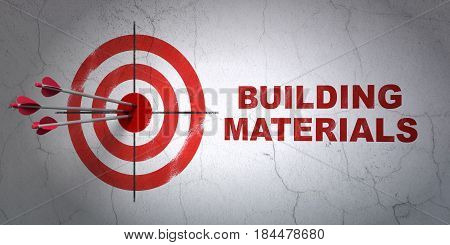 Success construction concept: arrows hitting the center of target, Red Building Materials on wall background, 3D rendering
