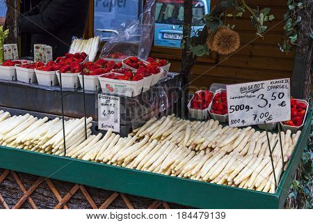 HEIDELBERG GERMANY - MAY 3 2013: Stall with fresh asparagus and strawberries at a farmers fair in Heidelberg old town Germany