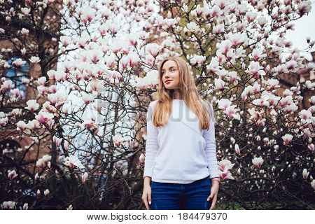Woman Against Magnolia Tree Flowers