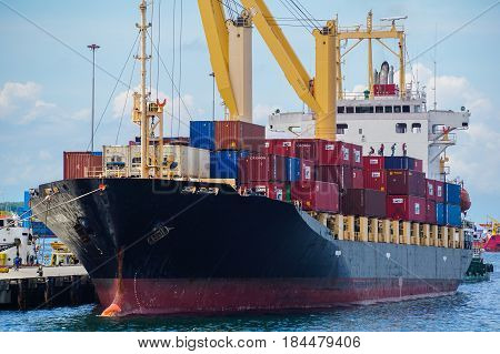 Labuan,Malaysia-June 17,2016:Cargo ship,full of shipping containers in the port of Labuan island,Malaysia on 17th June 2016