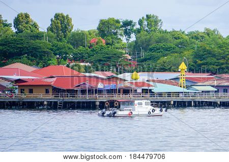 Labuan,Malaysia-June 17,2016:Traditonal houses in Patau-Patau floating water village at Labuan island,Malaysia.Patau-Patau floating water village is a attraction places in Labuan island,Malaysia.