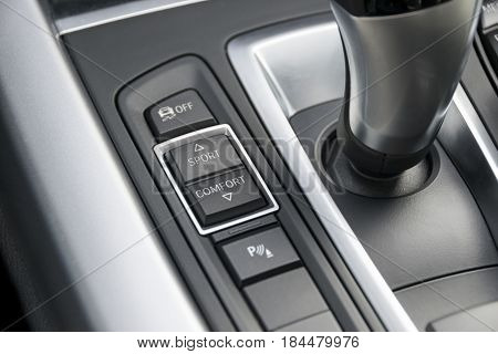 track control buttons near automatic gear stick of a modern car car interior details