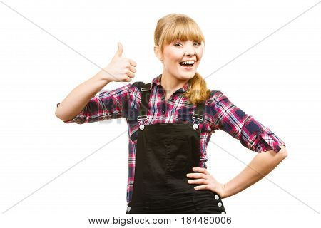 Gardening concept. Attractive woman in dungarees and pink check shirt showing thumb up. Isolated background