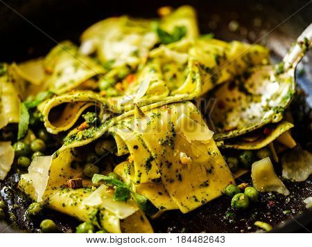 Close-up Of Pappardelle Pasta With Peas, Pesto, Mint And Cheese In Pan.