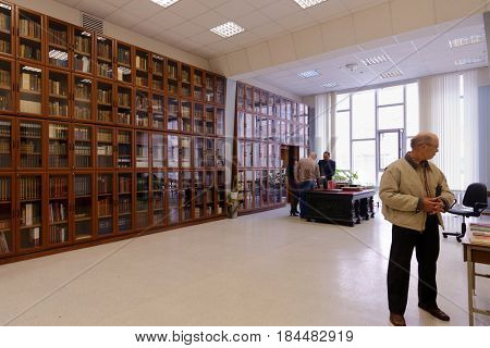 NOVOSIBIRSK, RUSSIA - OCTOBER 5, 2014: Library staff demonstrate rare books to the public during the 4th Russian Science Festival. The event aimed to popularization of science and technical advances