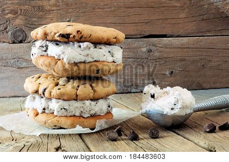 Homemade Ice Cream Sandwiches With Scoop Against A Rustic Wood Background