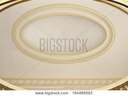 Elaborate oval gold design plaster on ceiling