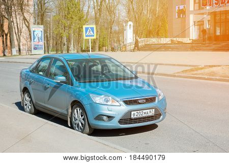 Smolensk, Russia - April 24, 2017: Ford Focus parked on the street of Smolensk City. Ford Focus in sunlight at beautiful day.