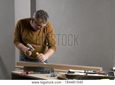 Carpenter Carving Plank with Chiesel