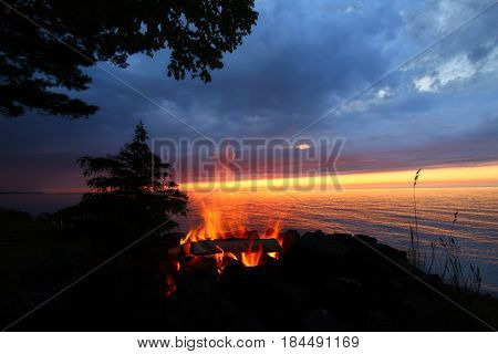 The beach of Lake Superior is a perfect place for a summer campfire poster