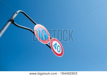 Speed limit and no parking sign in Japan.