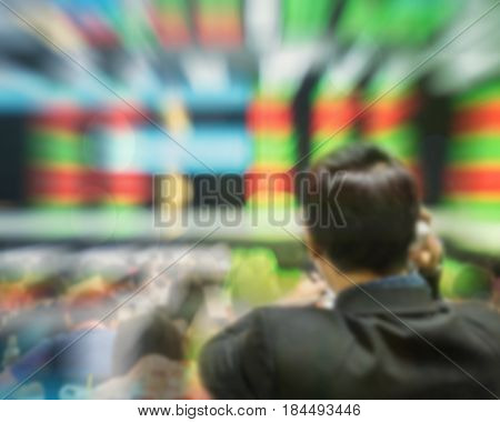 Motion blur of trader in the marketing room on blurred stock board background in business concept