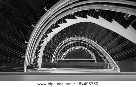 spiral staircase semicircle black and white tone abstract background selective focus