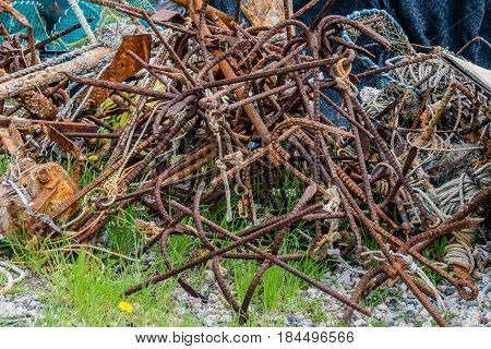 Closeup of large rusty iron grappling hooks used in fishing industry.