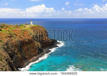 Lighthouse at the end of a point on a Pacific island