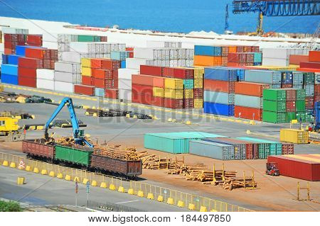 Container, Lumber And Train In Port