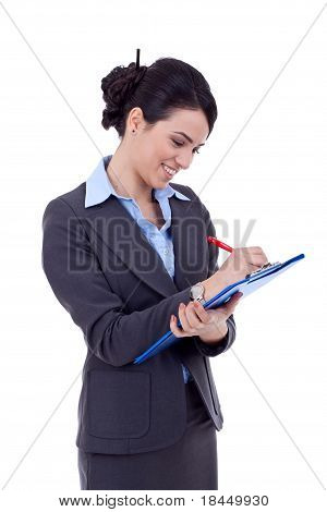 Business Woman Writing On A Clipboard