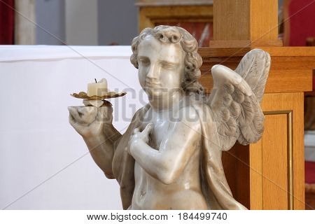 DUBROVNIK, CROATIA - NOVEMBER 08: Angel on the altar in Franciscan church of the Friars Minor in Dubrovnik, Croatia on November 08, 2016.
