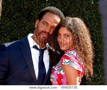 LOS ANGELES - APR 30:  Kristoff St. John, Lola St. John at the 44th Daytime Emmy Awards - Arrivals at the Pasadena Civic Auditorium on April 30, 2017 in Pasadena, CA