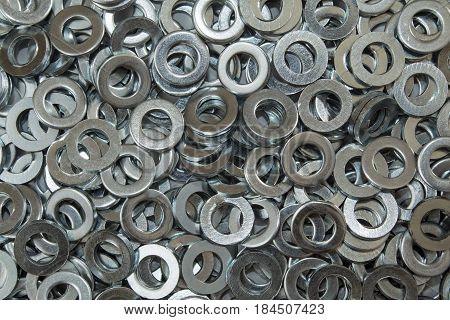 Metal washers in a pile close up from an overhead perspective