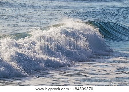 Close-up blue water and wave breaking on beach in South Africa