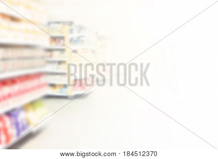 Hypermarket in blurry for background with aisle colorful shelves and defocused effect