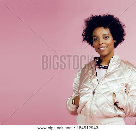 young cute disco african-american girl on pink background smiling adorable emotions copyspace, lifestyle people concept close up