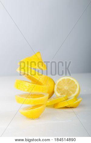 Flying Lemon. Sliced Lemon On White Background. Levity Fruit Floating In The Air.