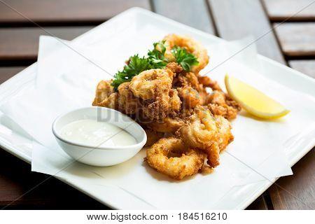 Fried Calamari ring go with sour sauce.