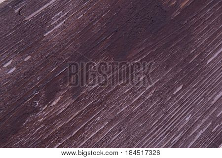 Brown wood texture in a diagonal pattern striving upwards