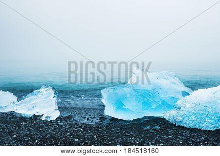 Ice On The Black Volcanic Sand. Jokulsarlon Ice Beach, Iceland.