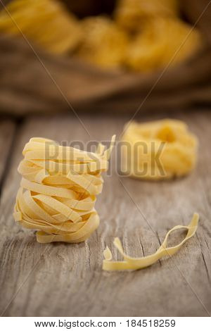 Close-up of fettuccine pasta on wooden table