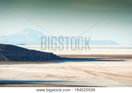 Top view of salt flat Salar de Uyuni at sunset Altiplano Bolivia