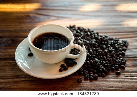 Americano coffee in white cup with coffee bean.