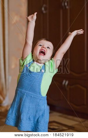 The little girl raised her hands and shouted cheers. Joy, emotions