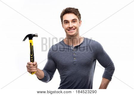 Handsome Man Holding Hammer Isolated On White, Handyman Tools Concept