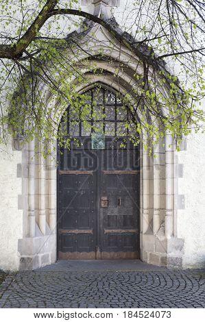 Entrance door into the Dreifaltigkeitskirche church in the town of Goerlitz, Germany
