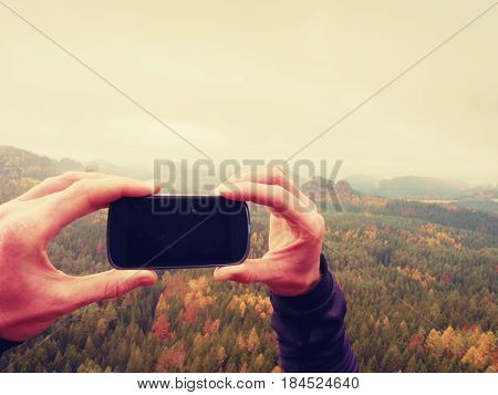 Black Phone Display. Dark Mobile Screen. Man Hands Takes Photos With Smart Phone On Peak Of Rock