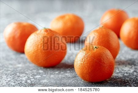 Delicious and beautiful Tangerines. Peeled Tangerine orange and Tangerine orange slices on a Dark Background. Citrus background