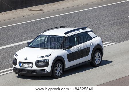 Frankfurt Germany - March 30 2017: White Citroen Cactus travelling on the highway