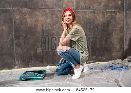 young smiling woman with various renovation tools renovation home concept