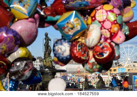 HELSINKI, FINLAND - MAY 1: Statue of Havis Amanda located at Kauppatori in downtown Helsinki seen through colorful balloons during First of May (Vappu) celebration May 1, 2017 in Helsinki, Finland.