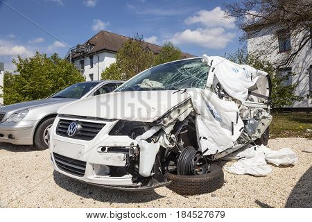 Frankfurt Germany - March 30 2017: White car damaged in an accident waiting for repair at the garage