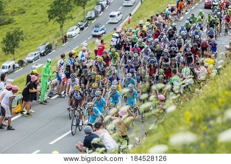 Col de PeyresourdeFrance- July 23 2014: Upper view of the peloton climbing the road to Col de Peyresourde in Pyrenees Mountains during the stage 17 of Le Tour de France on 23 July 2014.
