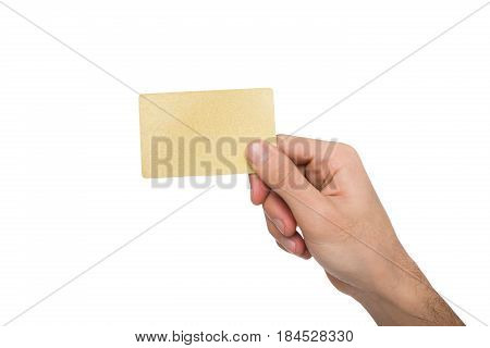 Close-up side view shot of male hand holding plastic credit card , man showing blank business card on white isolated studio background, copy space, cutout