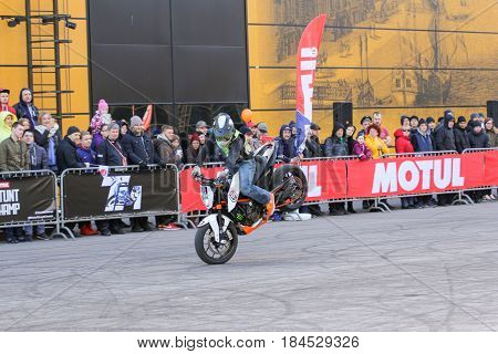 St. Petersburg Russia - 15 April, A trick in front of the audience on the front wheel,15 April, 2017. International Motor Show IMIS-2017 in Expoforurum. Sports motorcycle show of bikers on the open area.