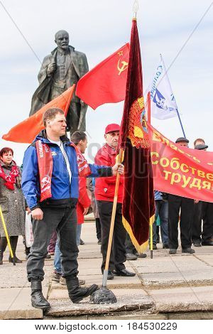Kirishi, Russia - 1 May, Protesters with flags,1 May, 2017. People at the May demonstration and rally in the Russian provincial government.